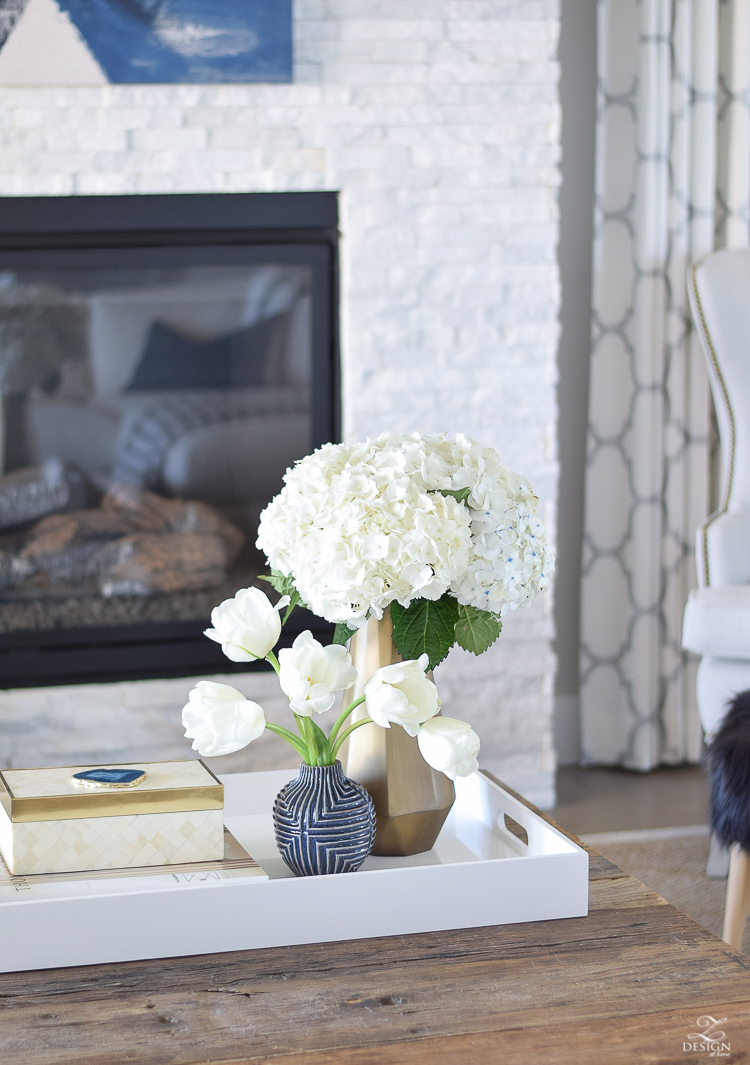 zdesign at home spring tour west elm blue patterned vase brass faceted vase white acrylic tray coffee table styling bone box white hydrangeas and tulips-1-2