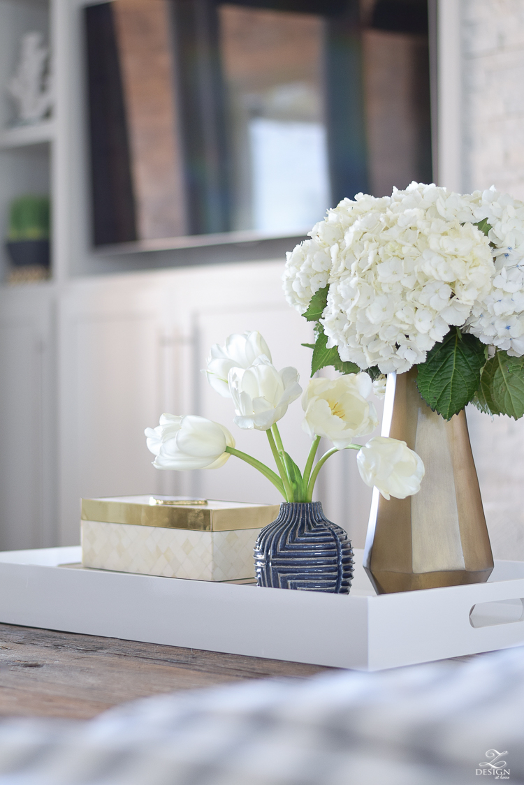 zdesign at home spring tour west elm blue patterned vase brass faceted vase white acrylic tray coffee table styling bone box white hydrangeas and tulips-1