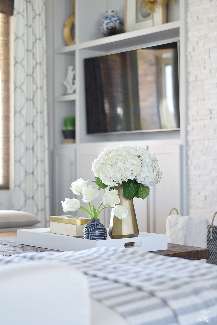 zdesign at home spring tour west elm blue patterned vase brass faceted vase white acrylic tray coffee table styling bone box white hydrangeas and tulips-2-2