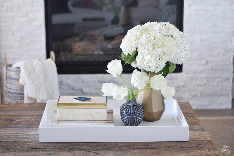 zdesign at home spring tour west elm blue patterned vase brass faceted vase white acrylic tray coffee table styling bone box white hydrangeas and tulips-2