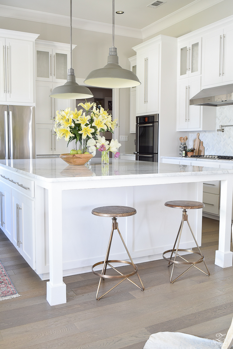 Best modern brass barstools white carrara marble counter tops white herringbone marble backsplash white modern farmhouse kitchen caitlin wilson rug-4