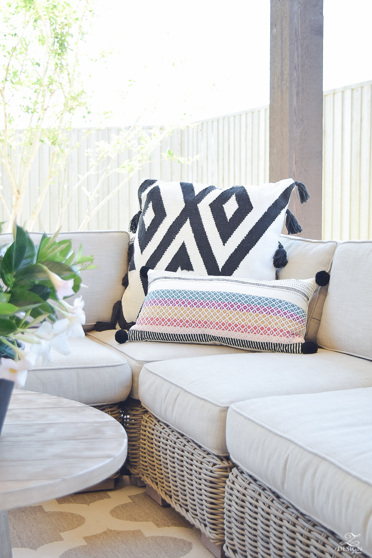 Spring outdoor living space rh rattan sectional black and white pillows with tassels outdoor entertaining-1