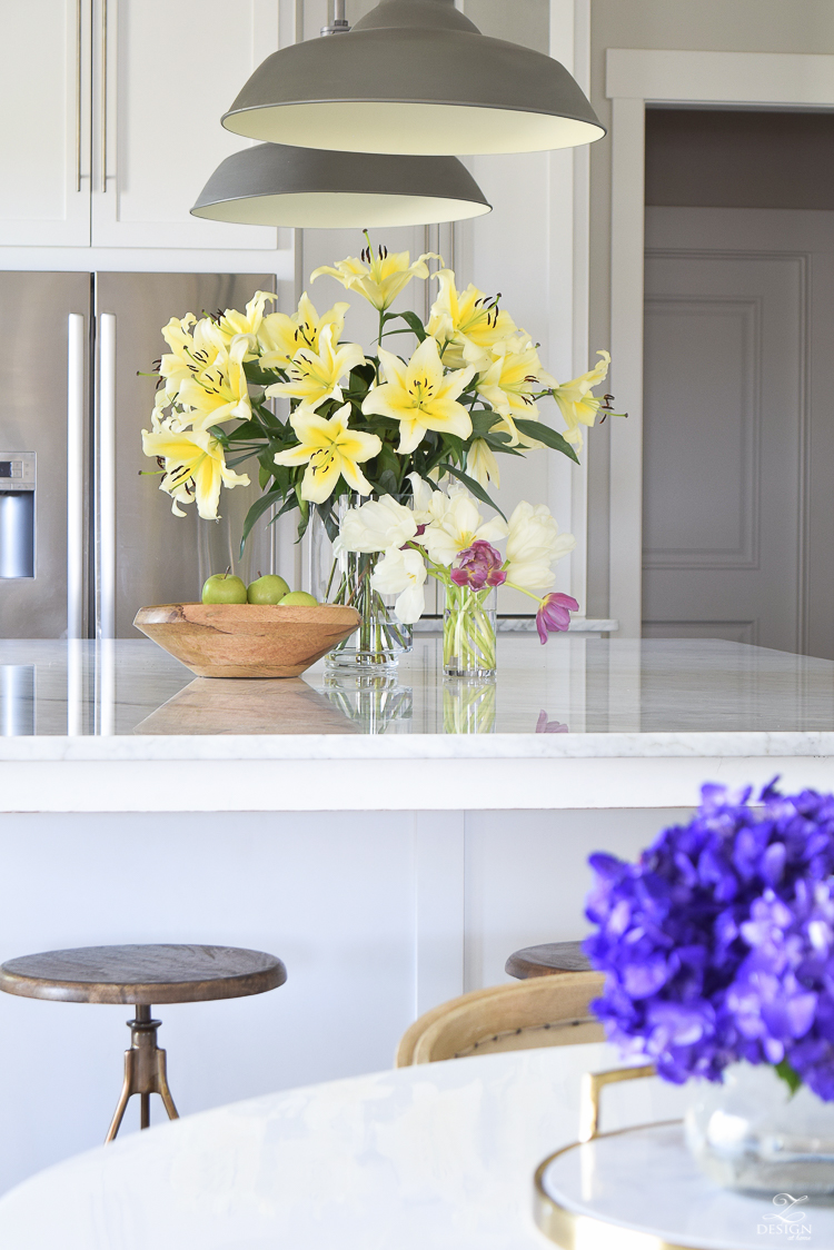 ZDeisgn At Home Spring In Full Swing Spring Tour easter lilies white modern farmhouse kitchen white carrara countertops backsplash stainless farmhouse sink-3