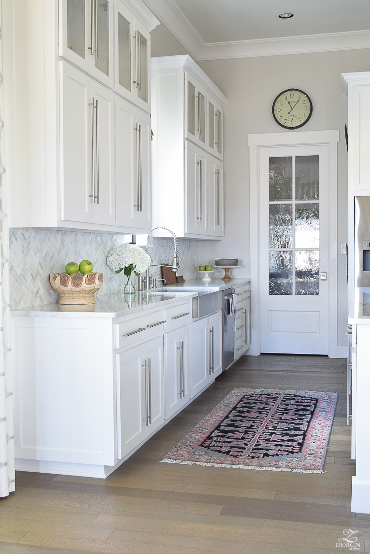 ZDeisgn At Home Spring In Full Swing Spring Tour easter lilies white modern farmhouse kitchen white carrara countertops backsplash stainless farmhouse sink caitlin wilson rugs