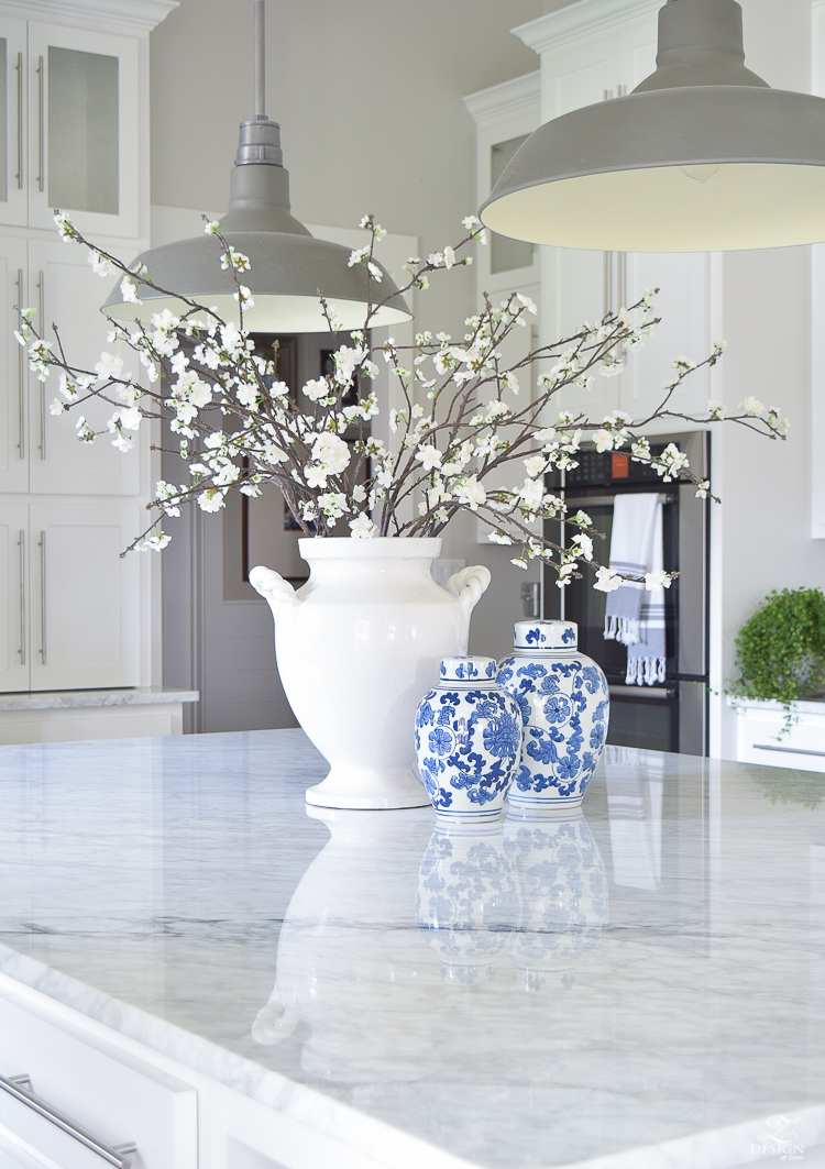 cozy and inviting home with blue and white ginger jars white blossoms white carrar marble white cabinets white farmhouse kitchen-1