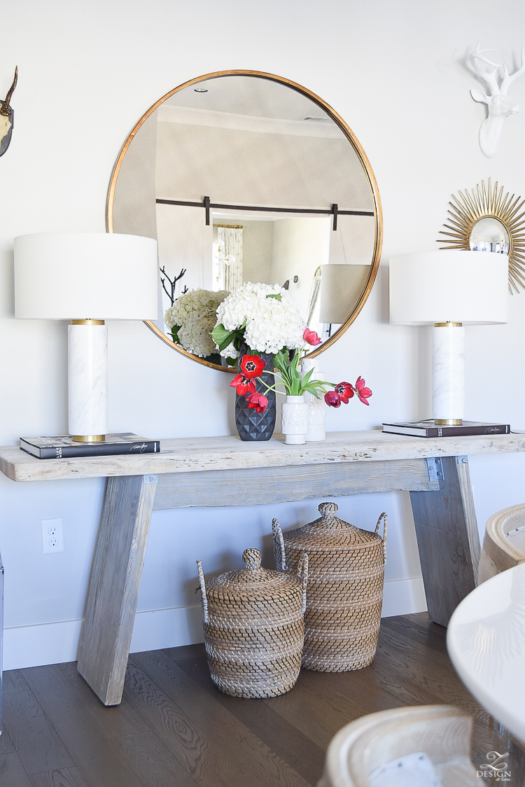 how to make a cozy and inviting home with flowers round gold mirror sw on the rocks modern rustic console table marble and brass lamps baskets under console-3