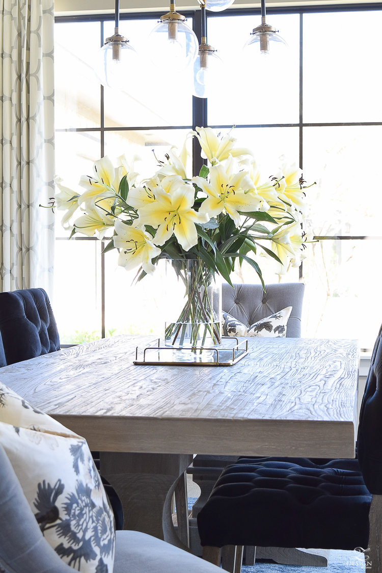 make your home feel cozy and inviting with flowers white bathroom transitional dining room gray rustic table marble backsplash yellow lilies
