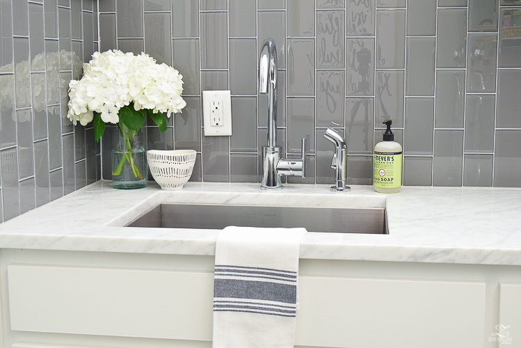 Beautiful laundry room ideas danze kitchen faucet stainless laundry room sink gray subway tile installed vertically white shaker cabinets large stainless bar pulls -1