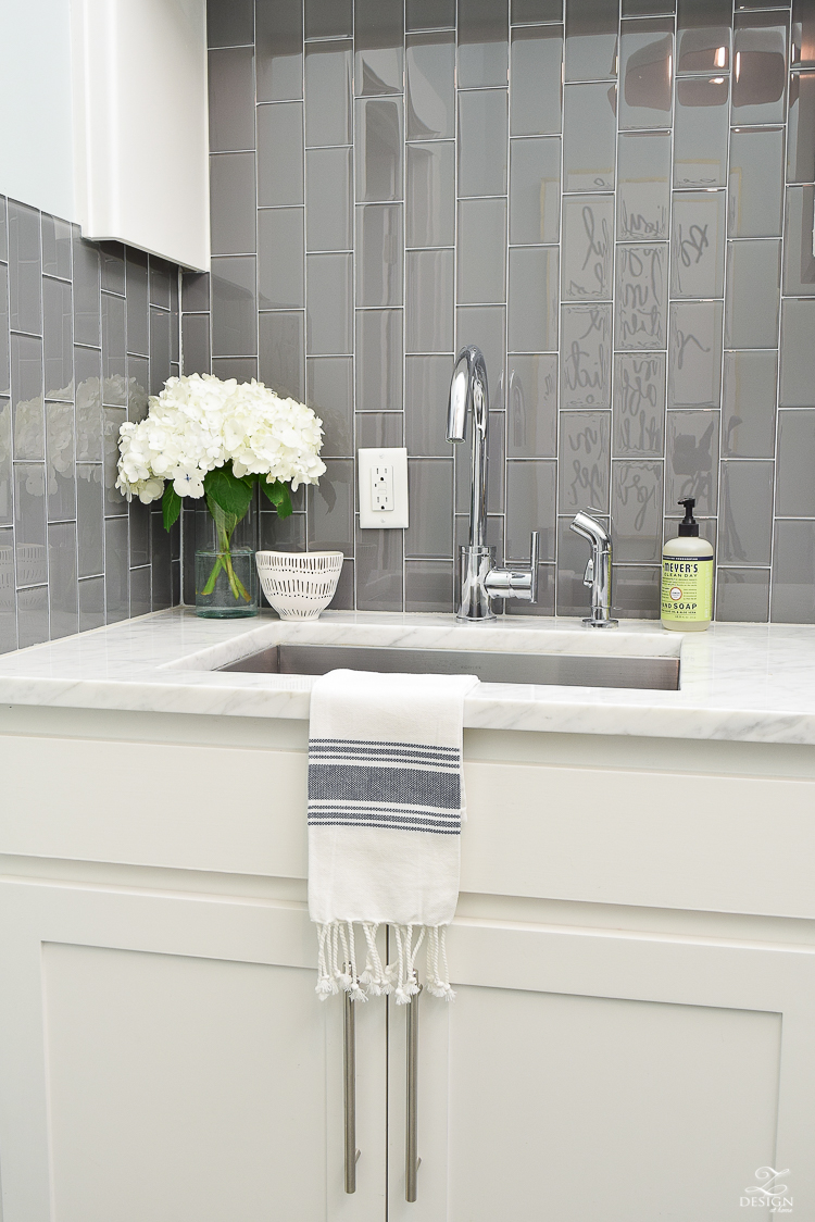 Beautiful laundry room ideas danze kitchen faucet stainless laundry room sink gray subway tile installed vertically white shaker cabinets large stainless bar pulls -5