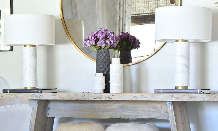Get the Look Round Gold Mirror Marble Table Lamps Fur Stools Trendy black and White Vases