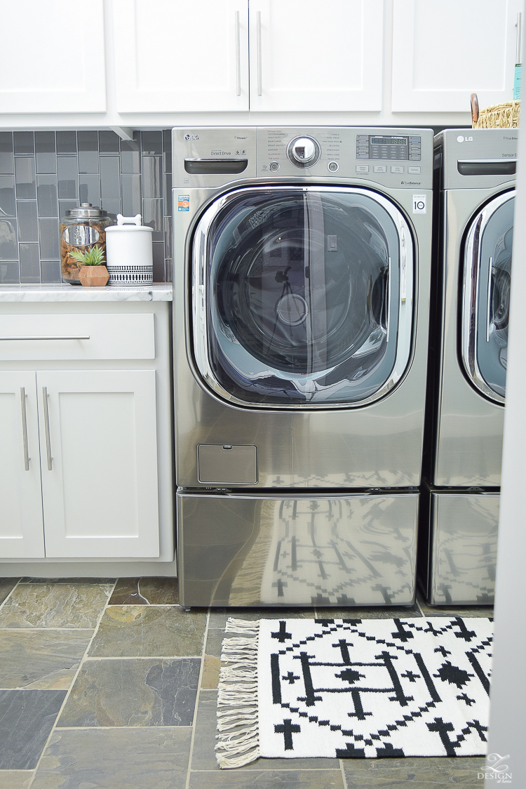 Laundry room ideas stainless LG washer and dryer slate flooring stainless bar pulls delta chrome faucet stainless sink-1