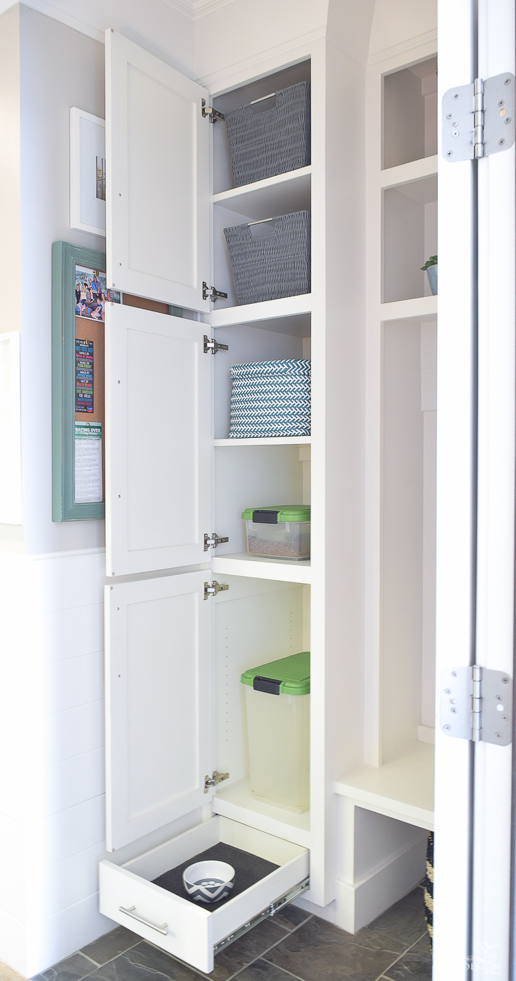 small mud room with pet storage and organization for dog food dog food bowl in drawer white shaker cabinets-1