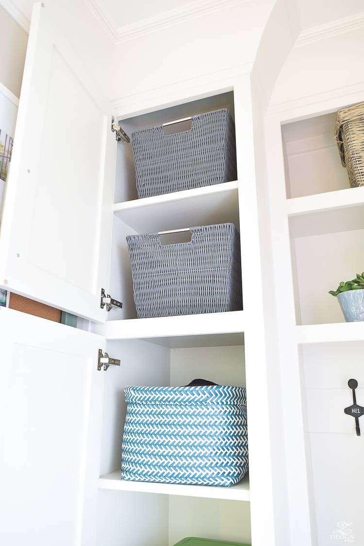 small mud room with pet storage and organization for dog food dog food bowl in drawer white shaker cabinets-2