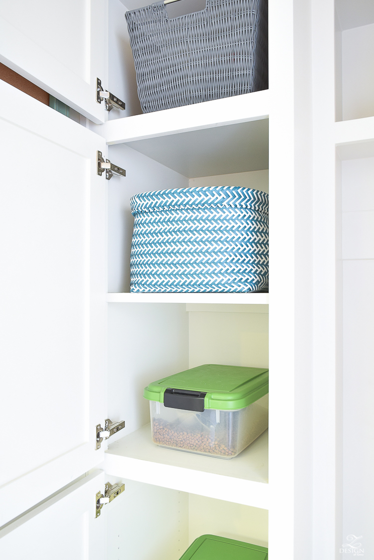small mud room with pet storage and organization for dog food dog food bowl in drawer white shaker cabinets-3