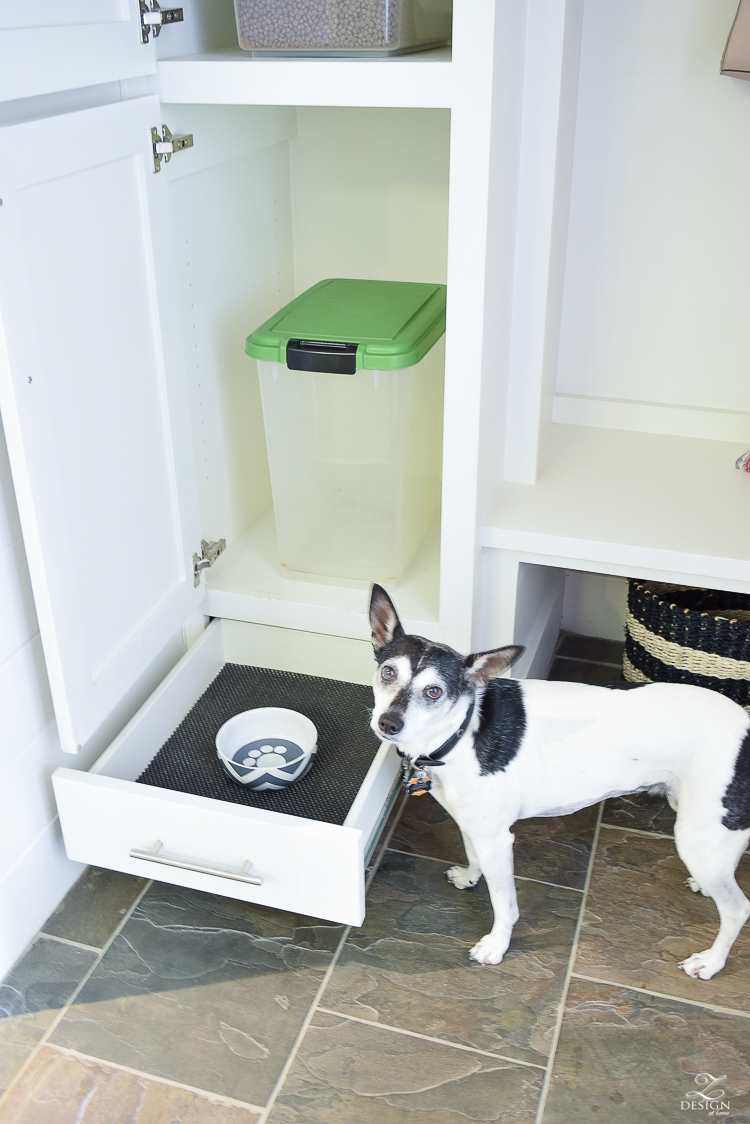 small mud room with pet storage and organization for dog food dog food bowl in drawer white shaker cabinets-4