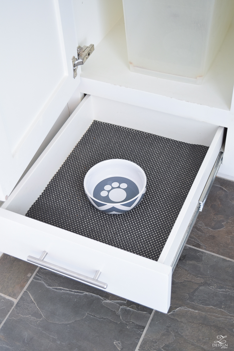 small mud room with pet storage and organization for dog food dog food bowl in drawer white shaker cabinets-5