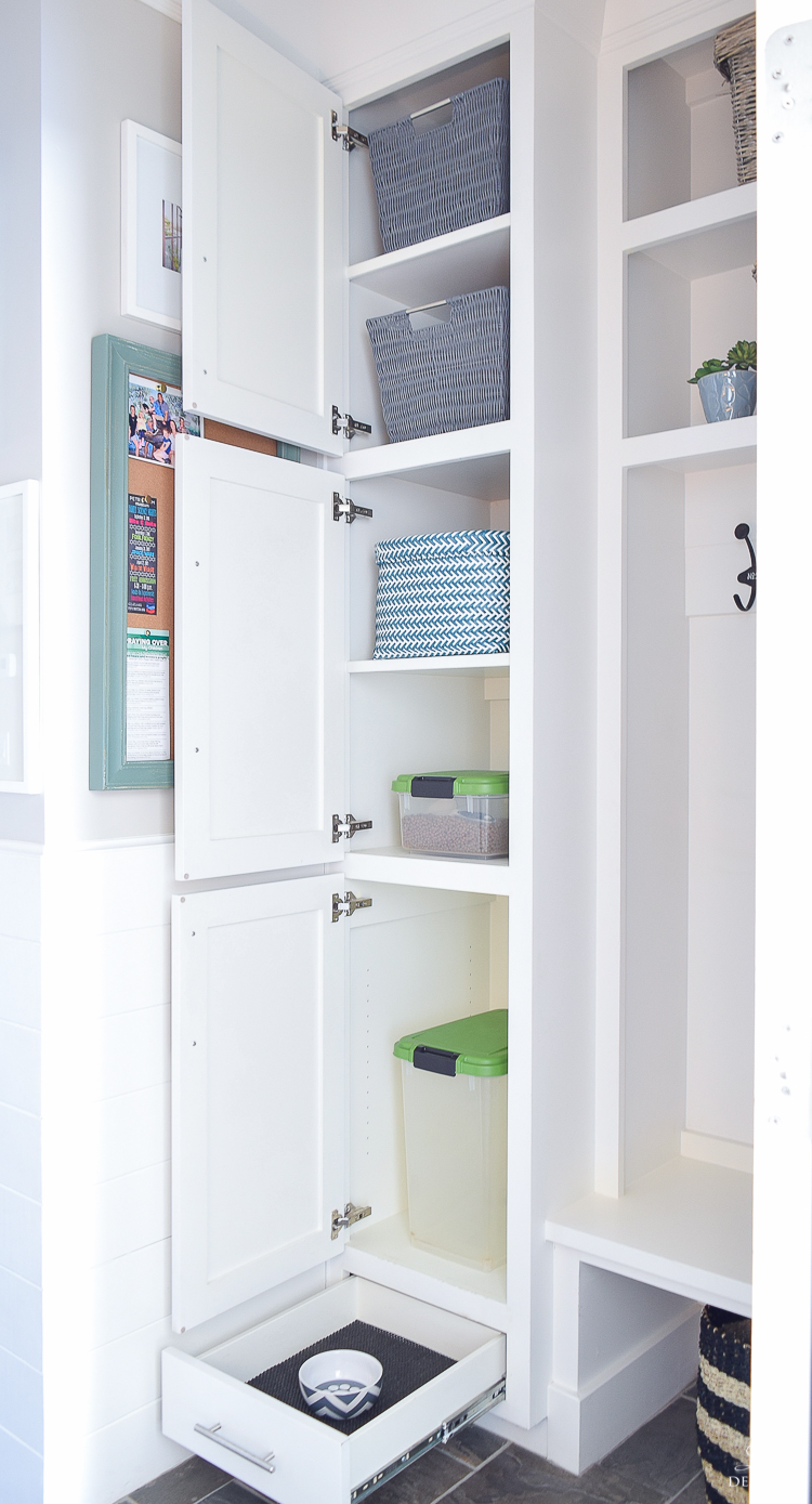 small mud room with pet storage and organization for dog food dog food bowl in drawer white shaker cabinets-7