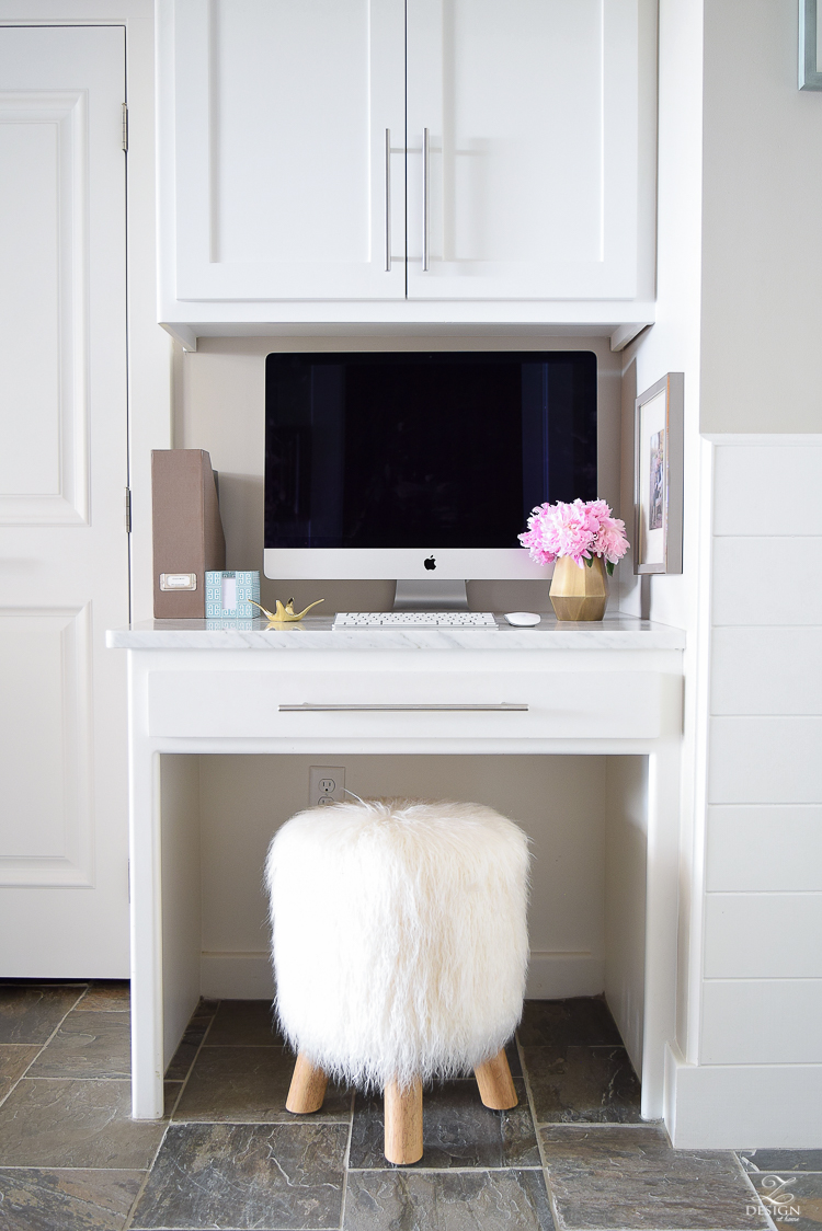 small office space organization printer stored away in cabinet on pull out drawer message center by back door fur stool girl boss office-1
