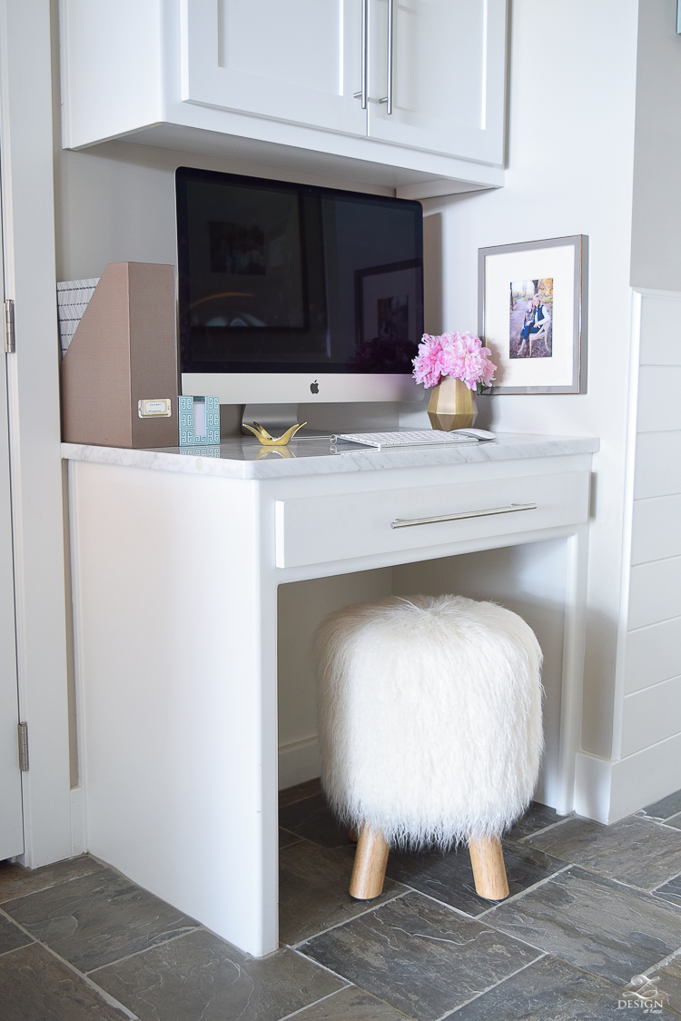 small office space organization printer stored away in cabinet on pull out drawer message center by back door fur stool girl boss office-2