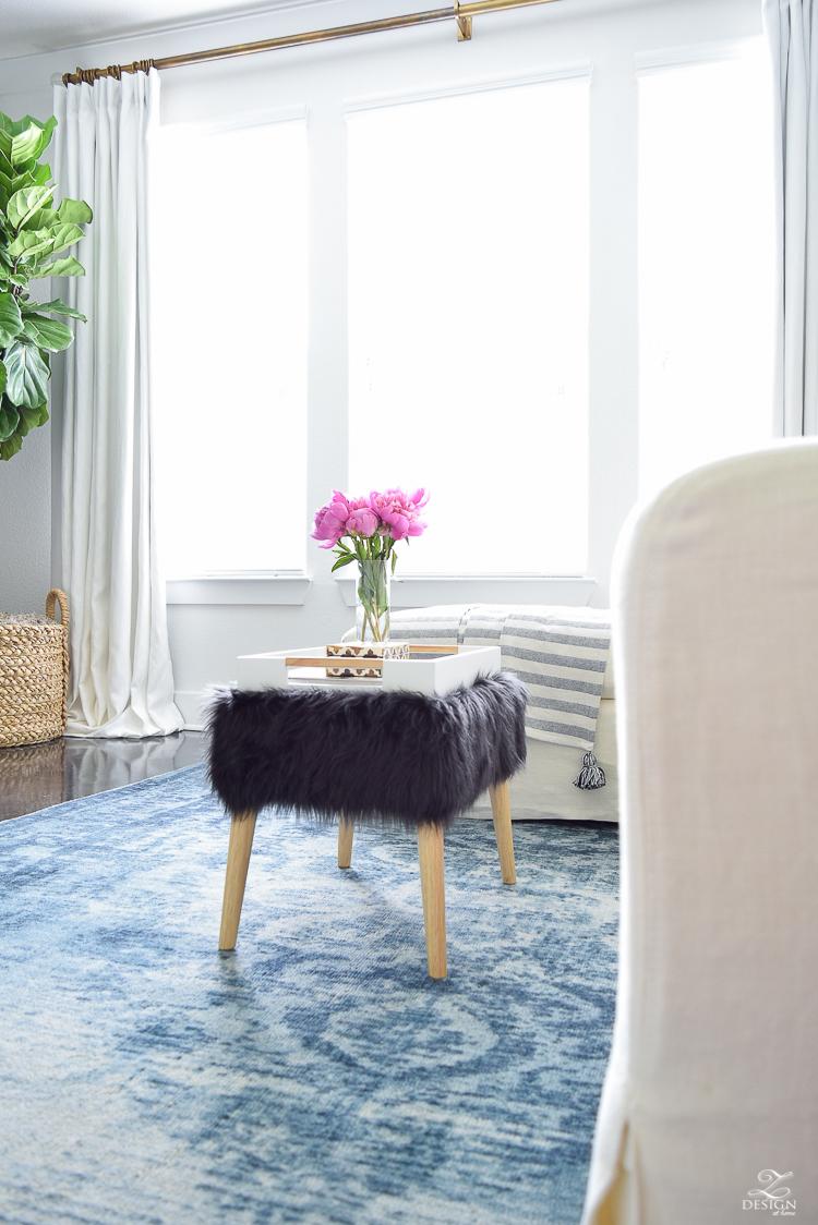 Summer living room tour black fur stool blue vintage inspried rug black and white tassel throw-7
