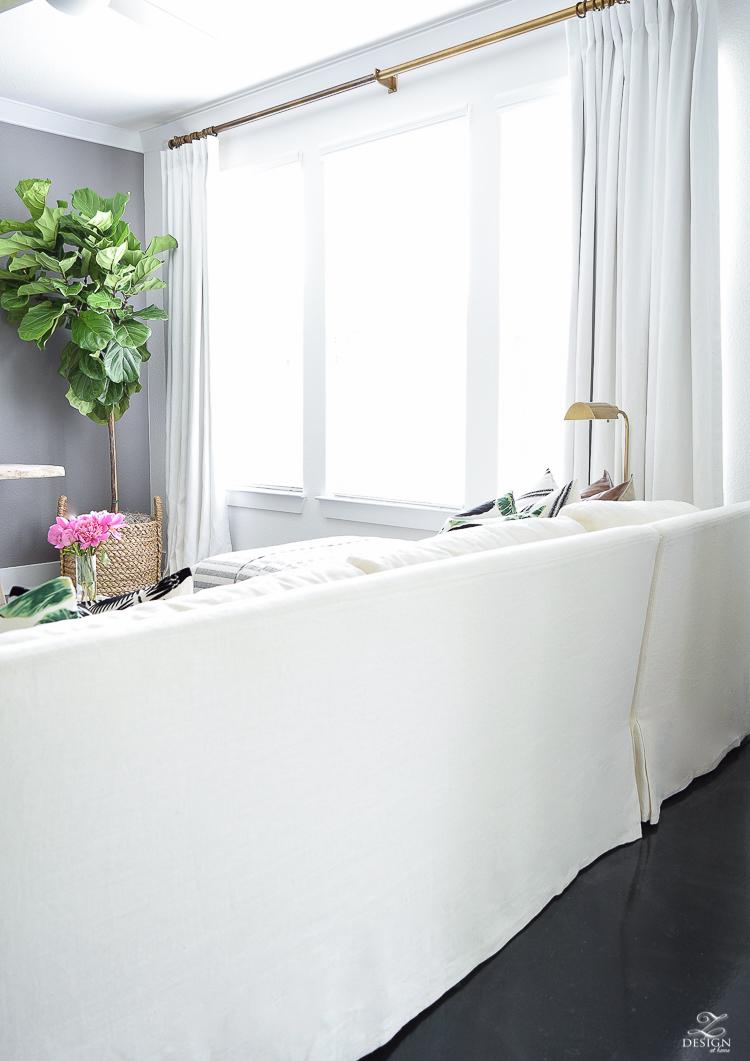 Summer living room tour black fur stool blue vintage inspried rug black and white tassel throw-8