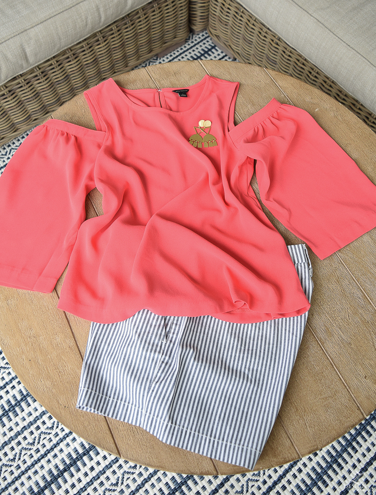 coral cold shoulder top madewell statemet earrings blue and white pin striped shorts -1