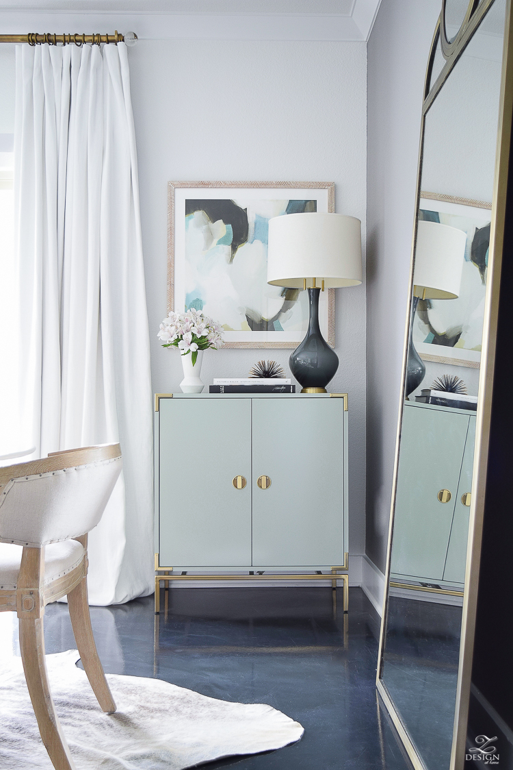 white linen drapes brass rod with crystal ball minted art gray lamp with brass base teal bar cabinet with brass accents black concrete floors console table styling-5