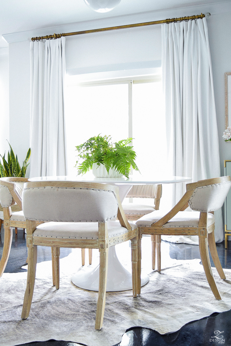 zdesign at home summer home tour white tulip table white linen drapes with brass rods black concrete floors modern white fluted pot-1