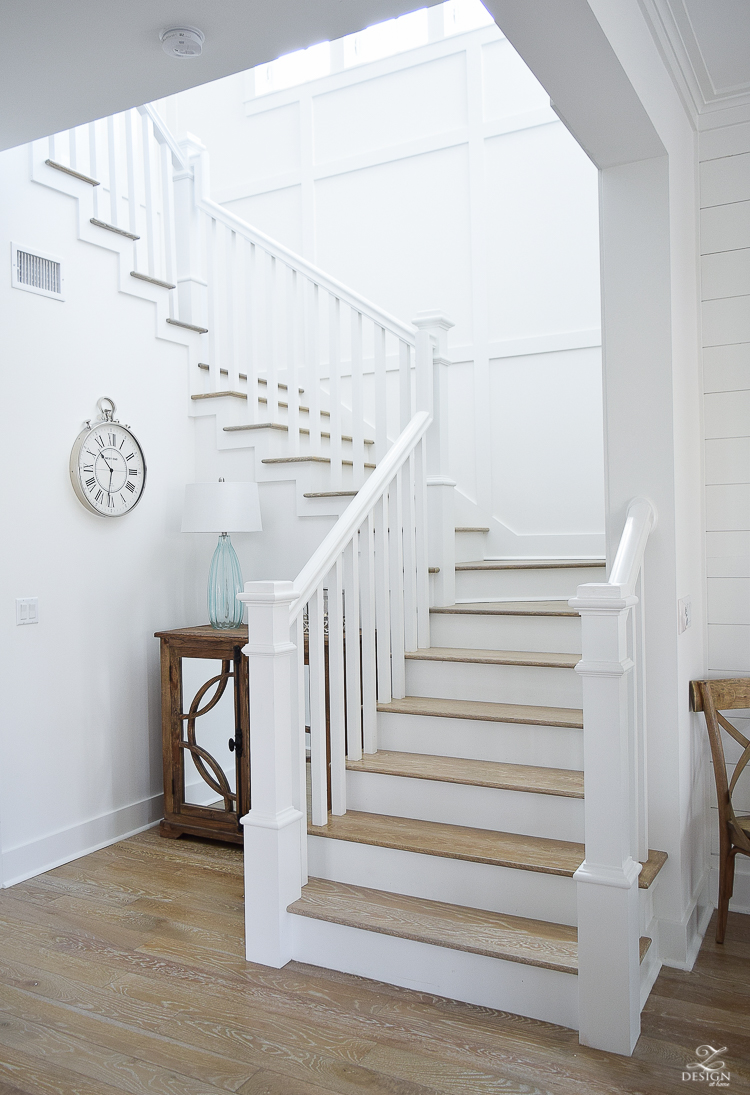 White staircase with grid pattern beach house decor beach house design coastal house design wooden handrail on staircase-1