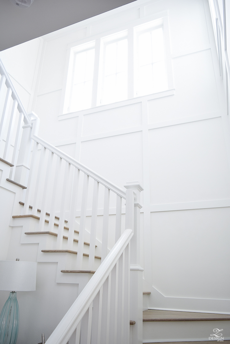 White staircase with grid pattern beach house decor beach house design coastal house design wooden handrail on staircase-2