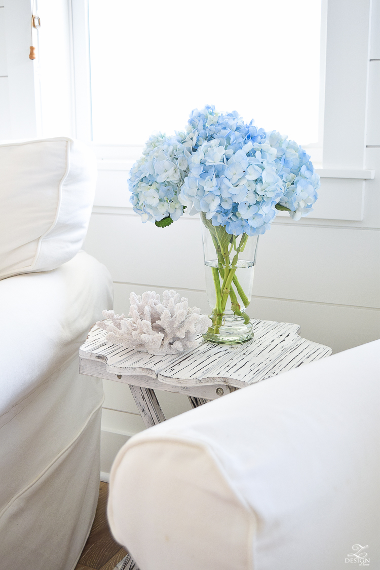 blue hydrangeas beach decor coastal living room design beach house living room decor beachy pillows white slipcovered chairs -1