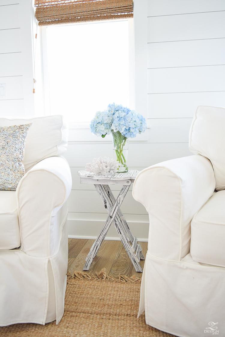 blue hydrangeas beach decor coastal living room design beach house living room decor beachy pillows white slipcovered chairs -2