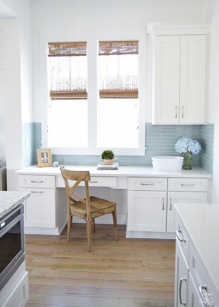 desk area in kitchen white shaker cabinets beach house decor desk in coastal kitchen windows over desk aqua glass tile distressed blonde wood floors-1