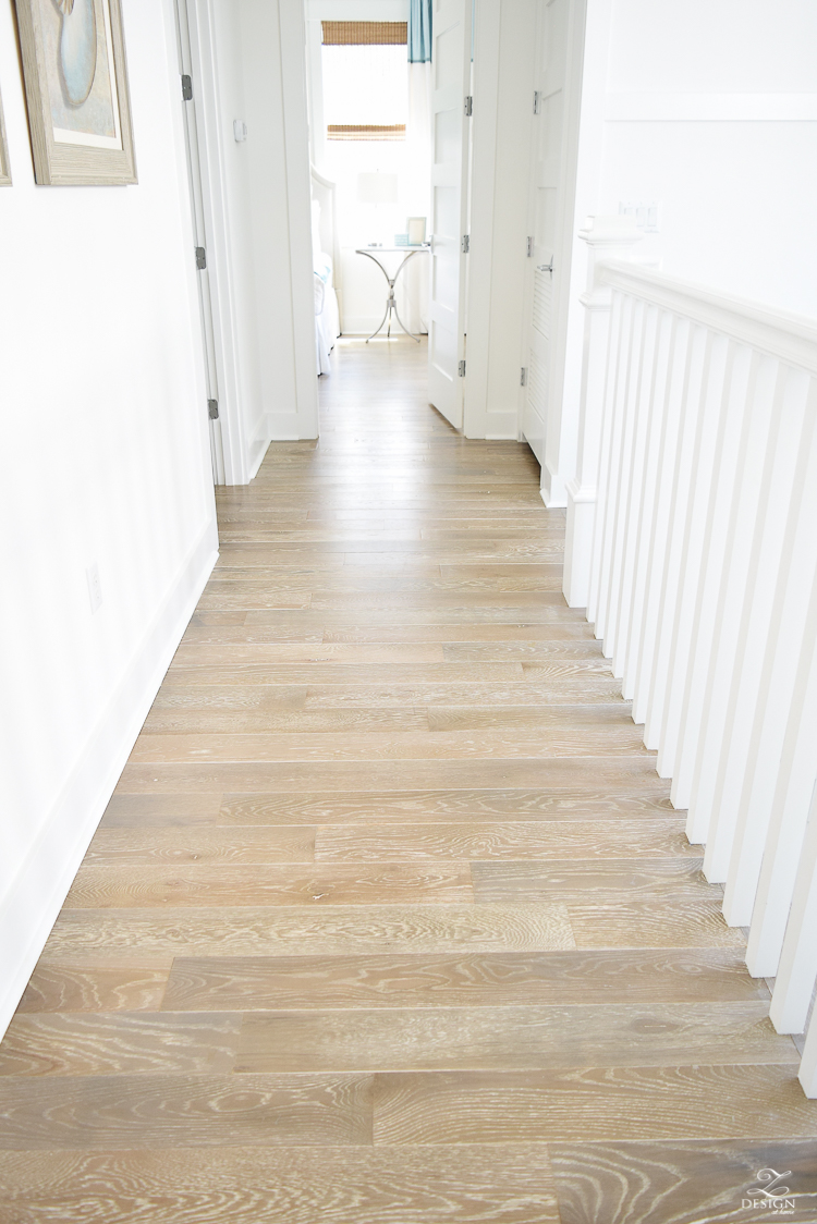 Grid wall pattern in staircase with white walls blonde for Beach house flooring