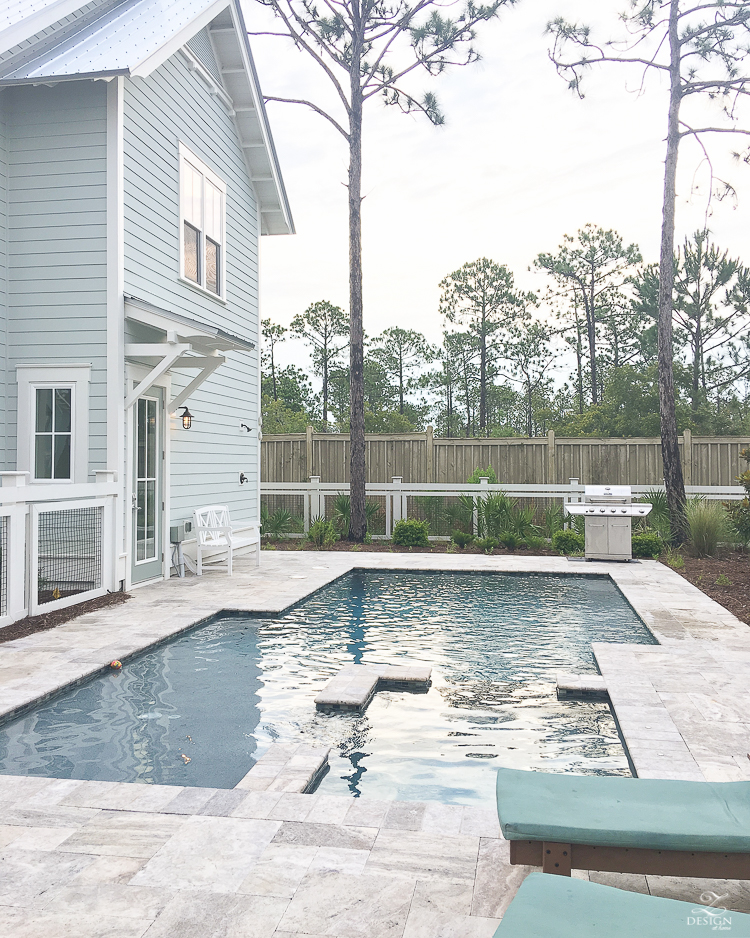 medium size modern pool with shallow end and hot tub area