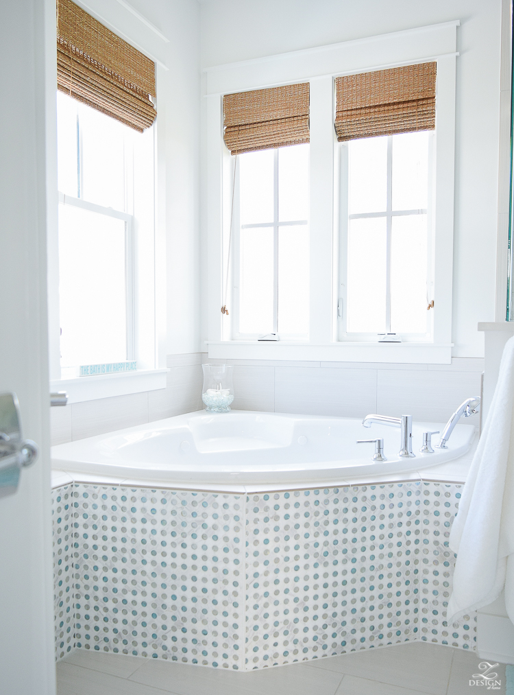 bathtub area in a coastal cottage home soaking tub in a beach house