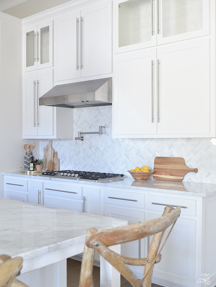 10 simple tips for styling the kitchen counters white modern farmhouse kitchen white shaker cabinets white carrar marble marble herringbone backsplash kitchen countertop decor-1