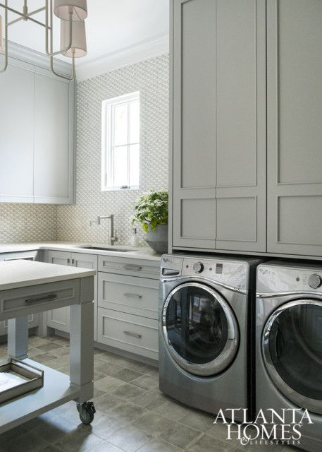 laundry room with gray cabinets and island