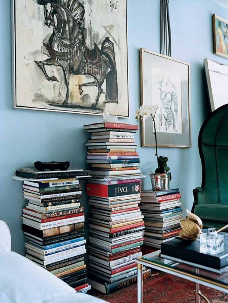 Decorating wtih Coffee Table books large stacks of books using books for a side table or coffee table stacked books against a wall-1