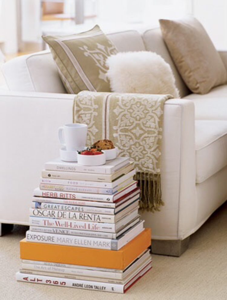 Decorating wtih Coffee Table books large stacks of books using books for a side table or coffee table stacked books against a wall-2