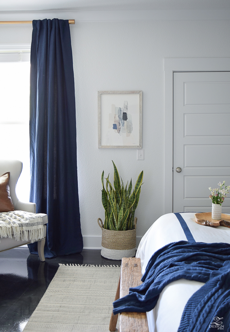 Minted abstract art Bedroom reveal navy linen curtains with blackout liner snake plant in basket navy and white banded bedding transitional style master bedroom-2