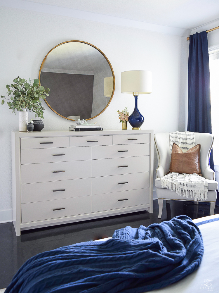 Transitional style master bedroom round gold mirror navy lamp with brass base dresser styling bedroom dresser decor modern gray dresser-2