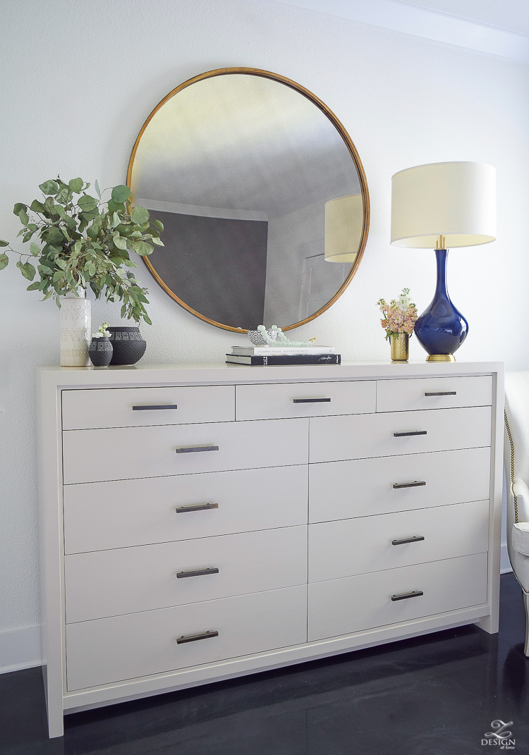 Transitional style master bedroom round gold mirror navy lamp with brass base dresser styling bedroom dresser decor modern gray dresser-5