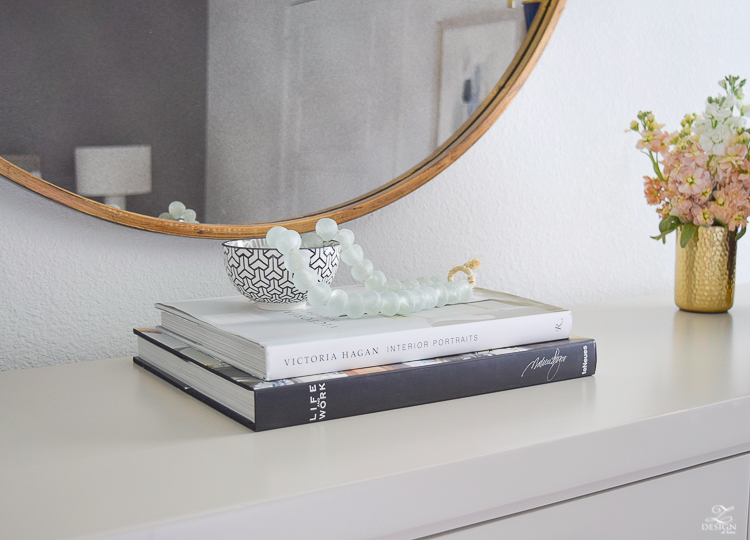 transitional style bedroom decor glass bead strand decorating with books round gold mirror black and white modern vases-2