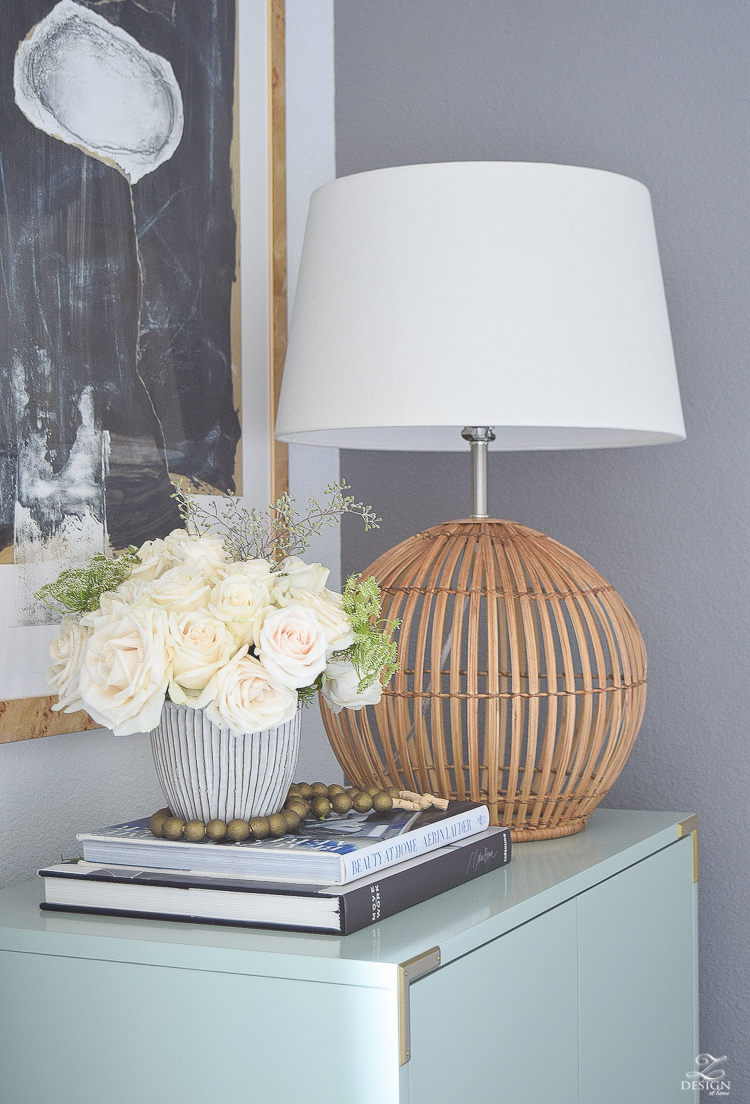 Rattan boho lamp gray decorative pot with white roses wooden bead strand erin lauder coffee table book aqua bar cabinet minted art-2