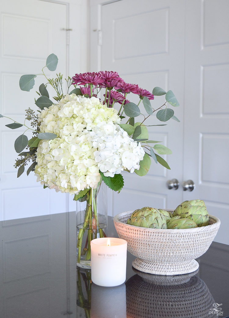 fall flowers mixed with hydrangeas rattan white washed fruit basket white pumpkin candle fall kitchen decor tall clear vase-2