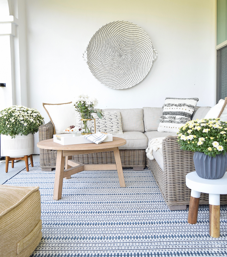 neutral fall patio a stroll thru life fall home tour hanging wall basket blue and white outdoor rug serene patio for fall fall decorating-2