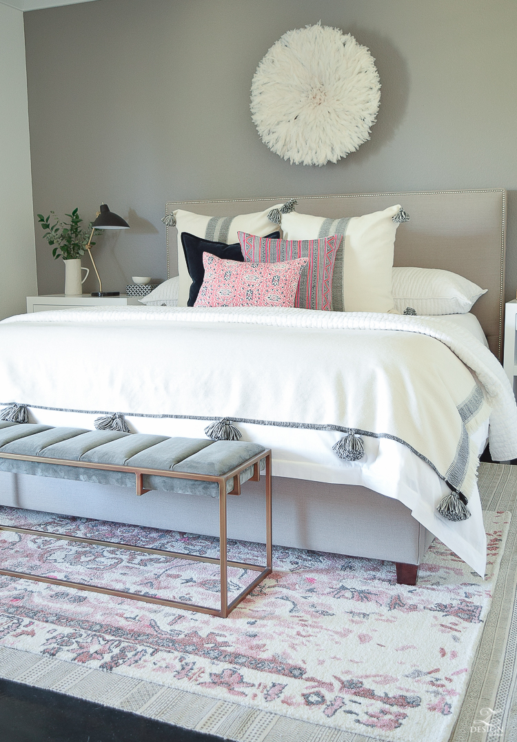 Romantic bedroom with Vintage inspired blush and gray rug plus tips for layering your rugs