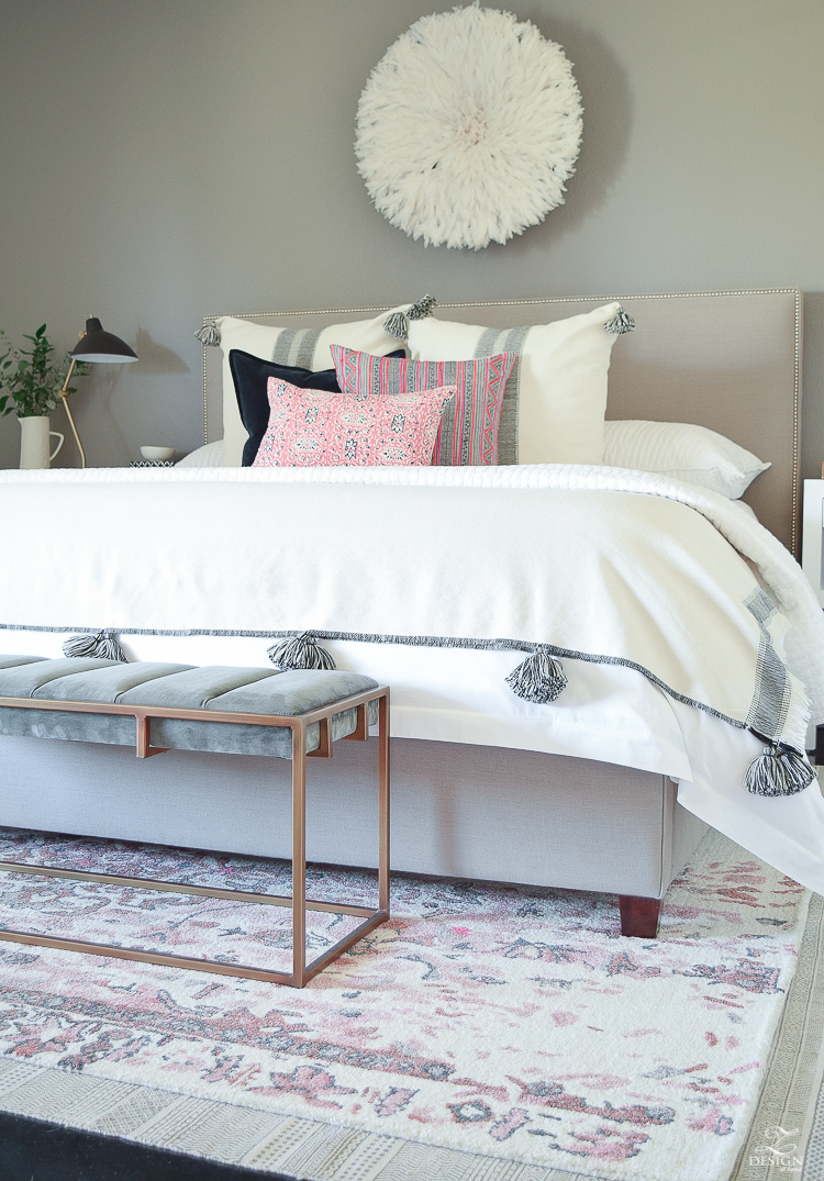 Vintage inspired blush and gray rug plus tips for layering your rugs