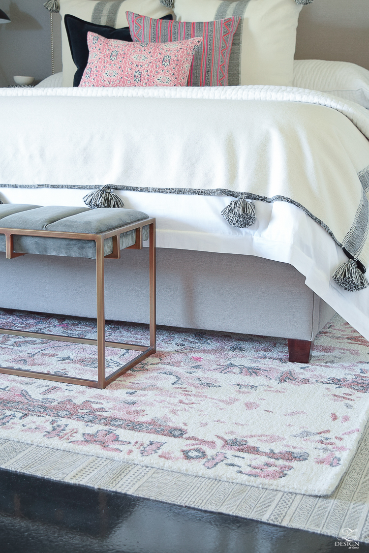 Vintage Inspired Distressed Motif Rug in blush and gray + tips for layering your rugs